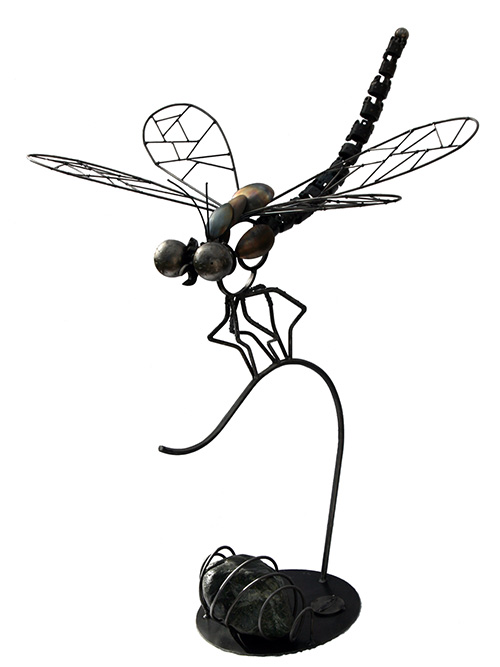 Intricate metal sculpture of a dragonfly by artist Ian Beyer